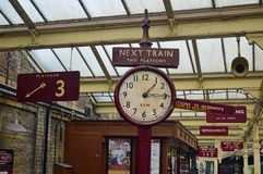 Station furniture at Bury Bolton Street Station. Old fashioned signage, clock and memorabillia at Bury Bolton Street Station on the east lancs railway The East royalty free stock photography