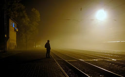 Station. A lone figure on Railway station in the fog Stock Photography