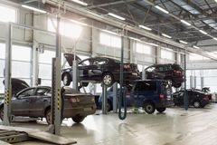Station for maintenance vehicles with cars Royalty Free Stock Photos