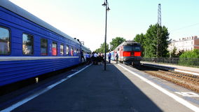 Station platform between two passenger trains stock footage