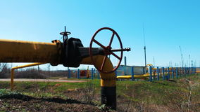 Station for processing and cleaning natural gas. Pipeline with shut-off valve. A refinery of oil and gas materials. Production of fuel. Natural resources stock footage