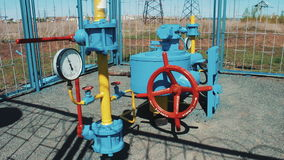 Station for pumping natural gas. Processing and storage of gas and oil. pumping station. Pipeline with a requested valve stock video footage