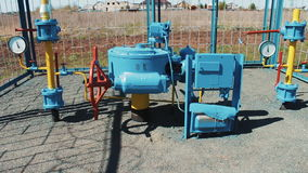 Station for pumping and purification of natural gas. Pipeline with a manometer. pumping station. Red check valve. Station for pumping and purification of stock video footage