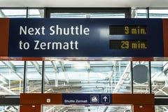 Station shuttle Zermatt. Train station shuttle zermatt, signpost waiting time stock photos