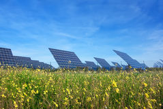 Station solar panels on a beautiful green lawn. Stock Photos