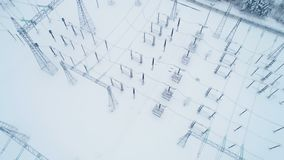 Station with transformers against winter landscape. Panoramic view station includes transformers to change voltage levels between high and low against winter stock footage