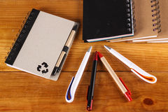 Stationaries. Isolated on wooden background Royalty Free Stock Photos