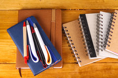 Stationaries. Isolated on wooden background Stock Photography