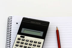 Stationary. Scientific calculator and pencil on a notebook Stock Photo