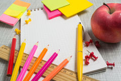 Stationary and apple with copy space. Stationary in pink and yellow color and apple with copy space Royalty Free Stock Image
