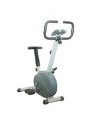 Stationary bicycle over white background Royalty Free Stock Photos