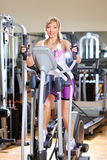 Stationary bicycles. Fitness girl. Stationary bicycles fitness girl in a gym sport club royalty free stock photos