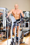 Stationary bicycles. Fitness man. Stationary bicycles fitness man in a gym sport club stock photography