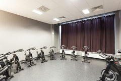 Stationary bicycles. Standing in a fitness gym Royalty Free Stock Photo