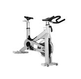 Stationary bike at the gym. Isolated on white Royalty Free Stock Photography