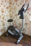 Stationary bike, gym machine Royalty Free Stock Images