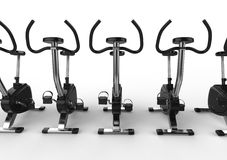 Stationary Bikes - Front View Closeup. Stationary bikes shot on white background, ideal for digital and print design Stock Photography