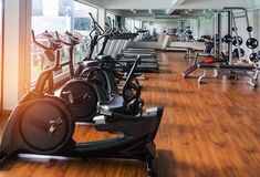 Stationary bikes and health exercise equipment in modern fitness center room Stock Photo