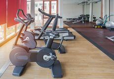 Stationary bikes and treadmills equipment health exercise in fitness center room. Stationary bikes and treadmills equipment  health exercise for bodybuilding in Royalty Free Stock Images