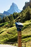 Stationary binoculars and Matterhorn mountain in Zermatt Royalty Free Stock Image