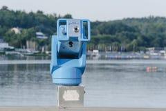 Stationary binoculars overlooking a lake Stock Photography