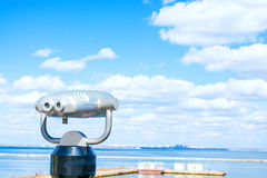 Stationary binoculars. Sea. Beautiful clouds background. Look into the distance. Stock Photos