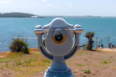 Stationary binoculars for tourists. In the background, the sea and the hills. Focus on the foreground Royalty Free Stock Image