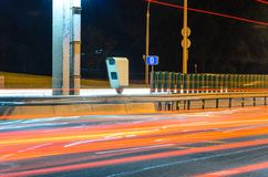 Stationary Car Speed Radar. Near a Highway Road. Night Road Traffic Background Royalty Free Stock Images
