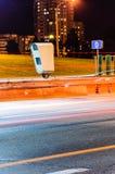Stationary Car Speed Radar. Near a Highway Road. Night Road Traffic Background Royalty Free Stock Photos