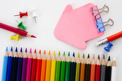 Stationary. And color pencil on white background Royalty Free Stock Photography