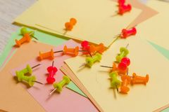 Stationary, Coloured Pushpins Lying on Blank Stickers Note Paper. Strategy Planning Concept. Stationary, Coloured Pushpins Lying on Blank Stickers Note Paper Royalty Free Stock Image