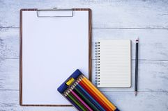 Stationary concept, blank notebook and blank paper on wood clipboard Royalty Free Stock Image