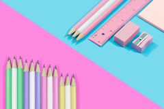 Stationary concept Flat Lay.  Stationary  pastel tone on blue an. D pink background with copy space Stock Photography