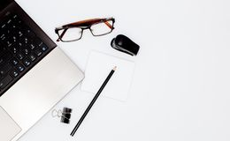 Stationary concept, Flat Lay top view Photo of laptop, pencil, stapled, paper clips, eyepieces, notes on white background with cop. Y space. Instagram Royalty Free Stock Photos
