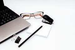 Stationary concept, Flat Lay top view Photo of laptop, pencil, stapled, paper clips, eyepieces, notes on white background with cop. Y space. Instagram Stock Photos