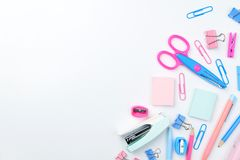 Stationary concept, Flat Lay top view Photo of school supplies s. Cissors, pencils, paper clips,calculator,sticky note,stapler and notepad in pastel tone on Stock Image