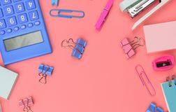 Stationary concept, Flat Lay top view Photo of Scissors, pencils. Paper clips,calculator,sticky note,stapler and notepad in pink and blue tone on pink Royalty Free Stock Images