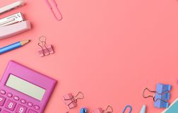 Stationary concept, Flat Lay top view Photo of Scissors, pencils. Paper clips,calculator,sticky note,stapler and notepad in pink and blue tone on pink Royalty Free Stock Photos