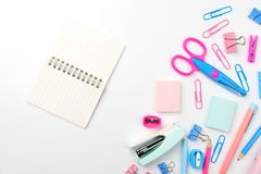 Stationary concept, Flat Lay top view Photo of Scissors, pencils. Paper clips, sticky note,staple with blank note pad in pink and blue tone on white background Royalty Free Stock Photos