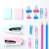 Stationary concept, Flat Lay top view Photo of Scissors, pencils. Paper clips, sticky note,stapler in pink and blue tone on white background with copy space Stock Images