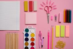 Stationary concept, Flat Lay top view Photo of Scissors, pencils, paper clips,calculator,sticky note,stapler and notepad in pink a. Stationary concept, Flat Lay Stock Images