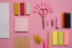Stationary concept, Flat Lay top view Photo of Scissors, pencils, paper clips,calculator,sticky note,stapler and notepad in pink a. Stationary concept, Flat Lay Royalty Free Stock Photos