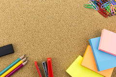 Stationary on cork board Royalty Free Stock Images