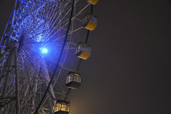 Stationary ferris wheel with a black sky, Shijingshan amusement park,Beijing,China. The wheel of the ferris wheel stops turning, in the light and dark stock image