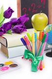 Stationary with flowers and books isolated Royalty Free Stock Photos