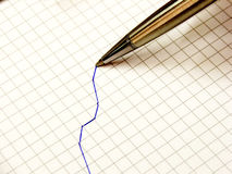 Stationary - graph and pen. Blue pen draws a line on graph paper stock images