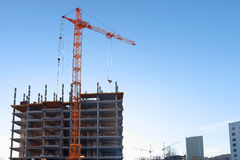 Stationary hoist and building under construction Royalty Free Stock Photos