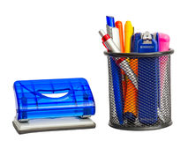 Stationary holder with school and office items and puncher. Royalty Free Stock Photo