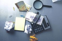 Stationary and money on desk royalty free stock images