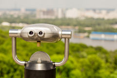 Stationary observation binoculars , metropolis landscape on the Royalty Free Stock Photo